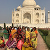 locals pose in front of the Taj