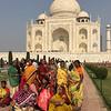 locals pose in front of the Taj