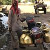 Milkman delivering fresh milk to the village