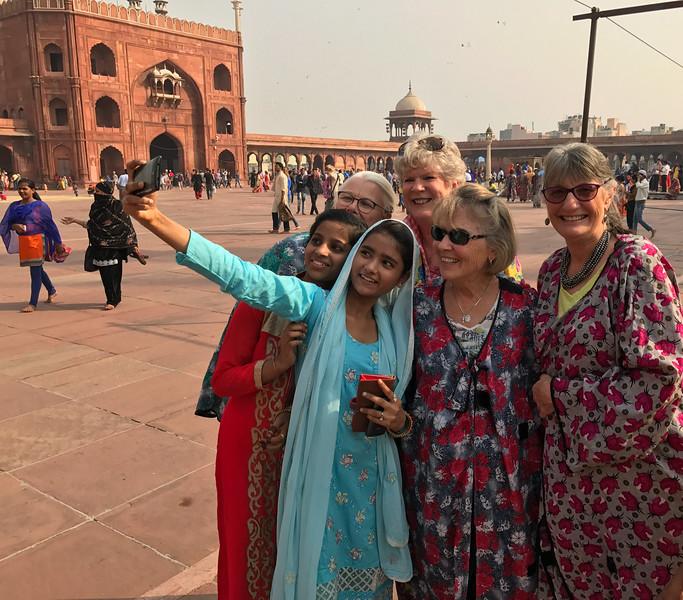 Sue, Karen, Bev and Barb join local girls for selfie at Muslim Temple Jama Masjid