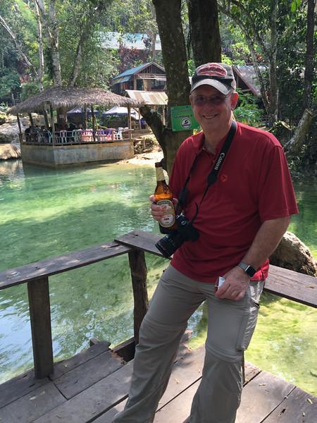 sharing a beer at the waterfall