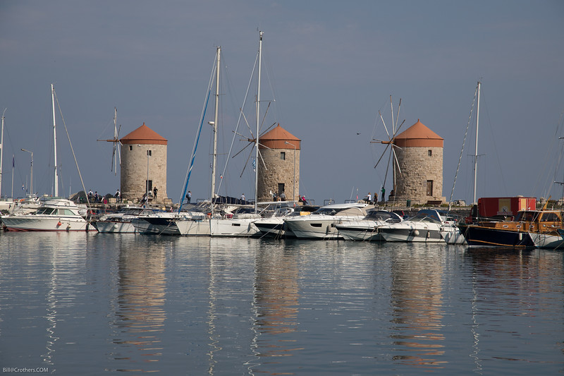 Rhodes windmills in the harbor.