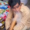sampling tobacco at Bac Ha market