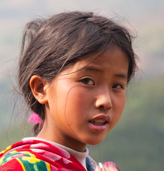 Red Dao girl with sibling, Sapa Vietnam
