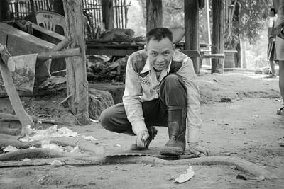 Countryman sharpening a handsaw.