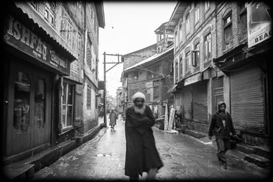 Kashmiri men in old street in central Srinagar