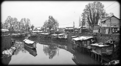 Huts on river in city Srinagar, Kashmir Dec 2003