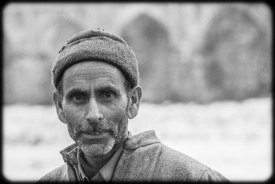 Kashmiri man in Srinagar gardens in winter