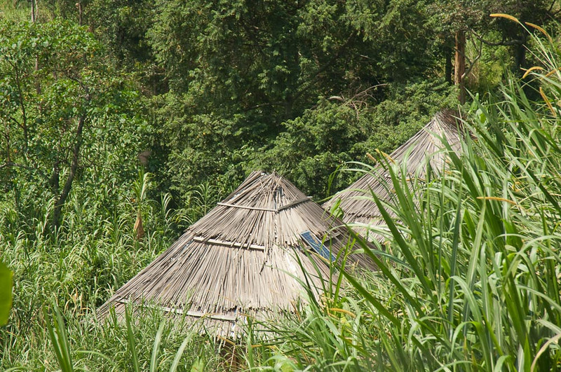 Huts on the approach walk. Note the solar cell on the roof