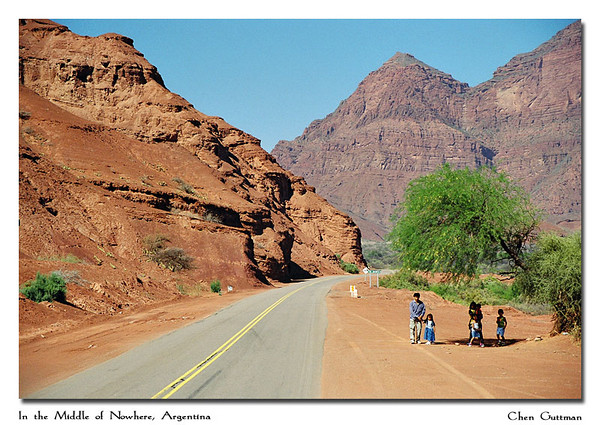 Family waits for the local bus in the middle of nowhere (in the area north of Cafayate)