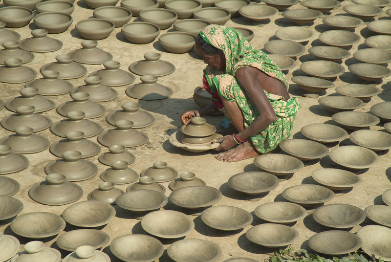 Woman in green in the potters village