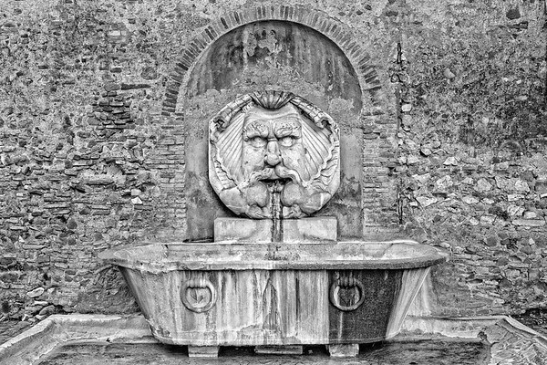 The Fontana del Mascherone di Santa Sabina welcomes the visitors of the Garden of the Oranges in Rome