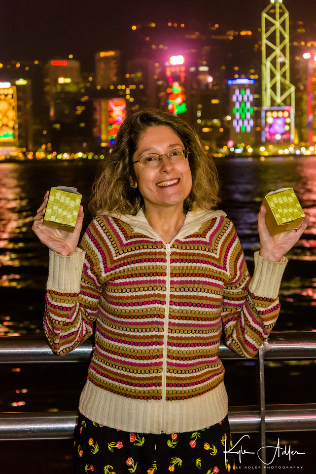 A post-postprandial peregrination along Hong Kong's harbor allows us to say farewell to the city before flying home the next morning.  Mary displays the little packages of tea given to us by Yan Toh Heen Restaurant.