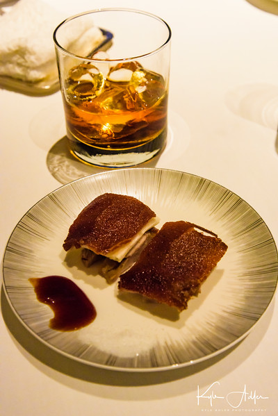 The crispy barbecued duck was delicious with my cocktail.
