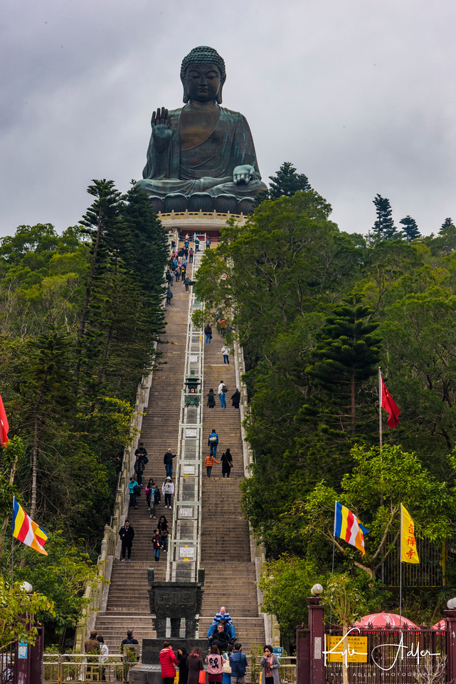 The giant Tian Tan Buddha towers above its surroundings.