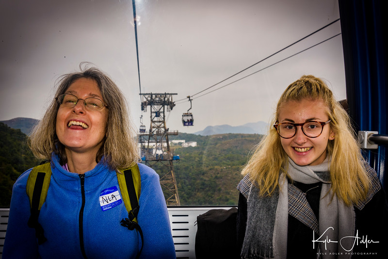 Mary rides with our new Australian friend Sammy on the cable car.