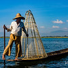 During our explorations on Inle lake we met many fishermen who still practice the ancient methods of rowing with one leg against the oar and of fishing with a large netted wooden basket.