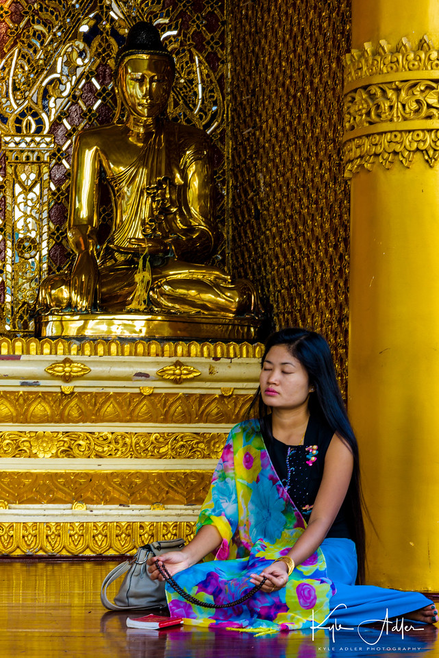 A worshiper at Shwedagon Pagoda, the most sacred Buddhist site in all of Burma.