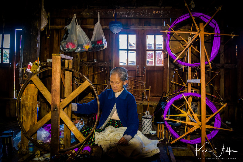 Traditional spinning methods to create yarn from the lotus fiber.