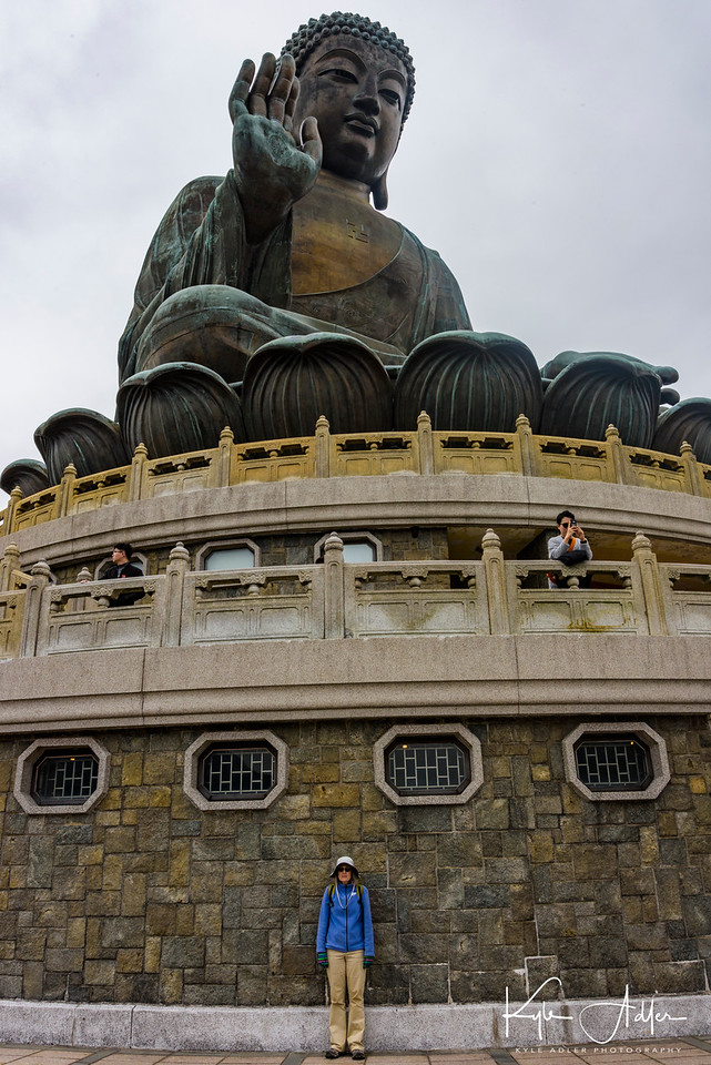 Mary serves as a scaling factor in front of the Tian Tan Buddha.