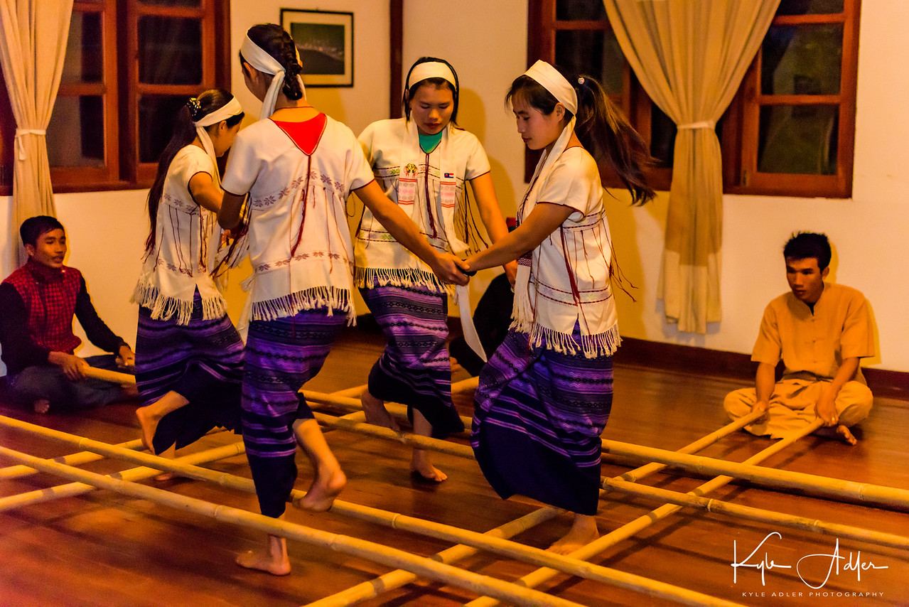 This vigorous dance involves timing the footwork in coordination with the opening and closing of the bamboo poles.