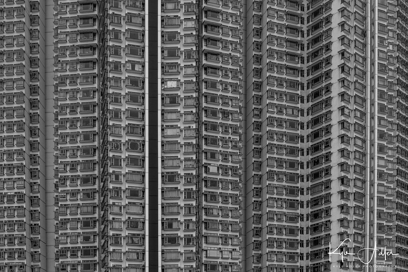 Hong Kong has had a severe housing shortage for centuries.  In a modern attempt to alleviate the crunch, city planners have been building huge housing developments in the New Territories, like this complex on Lantau Island.