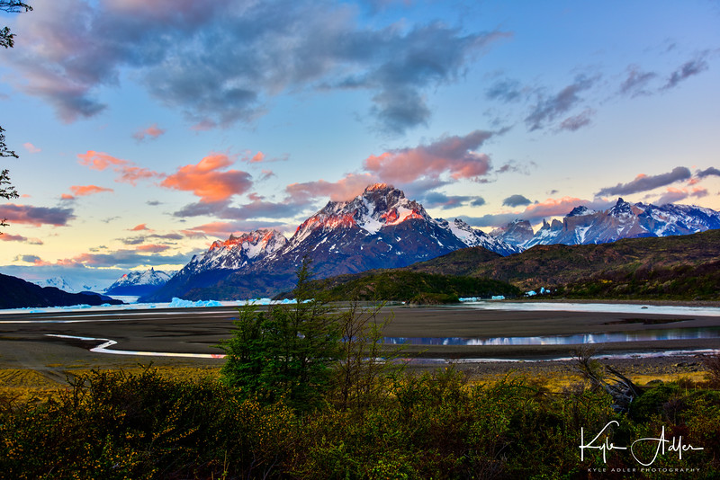 Alpenglow illuminates Lago Grey and its glacier in Torres del Paine National Park.