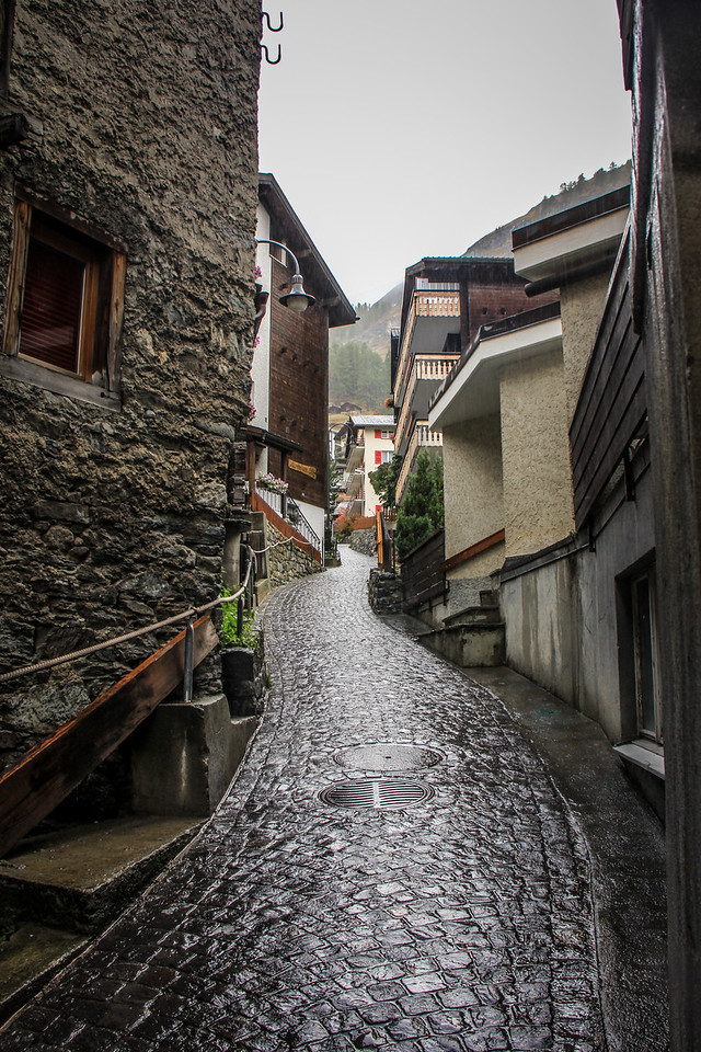 a lonely, wet street in Zermatt