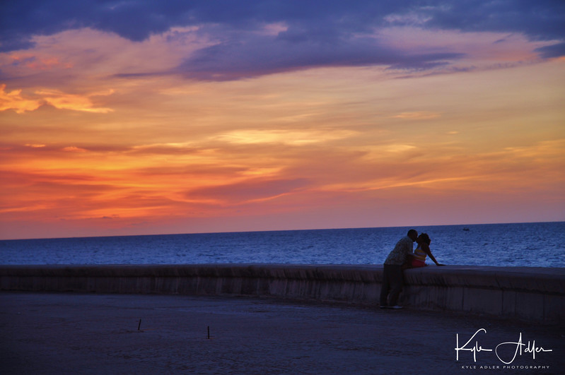 Lovers Embrace On Havanas Malecon At Sunset Buy This Photo