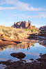Early morning shot of a mesa in the Valley of the Gods with a reflecting pool