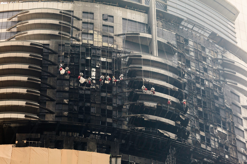 DUBAI - JANUARY 16: The address hotel caught fire on the new years eve. The reconstruction has begun and here workers are covering it up as seen on January 16, 2016.