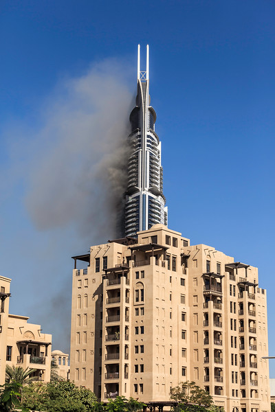 DUBAI - JANUARY 1: The address hotel got fired on the new years eve. This is the aftermath the next day which still shows the hotel is on fire as seen on January 1, 2016.