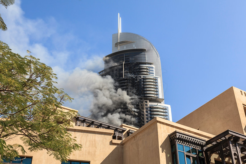 DUBAI - JANUARY 1: The address hotel caught fire on the new years eve. This is the aftermath the next day which still shows the hotel is on fire as seen on January 1, 2016.