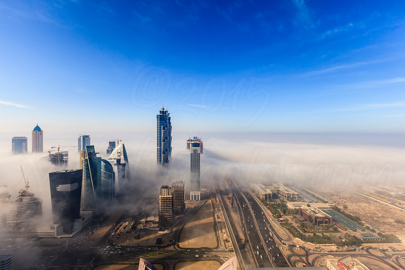 Early morning fog is covering Dubai business bay area.