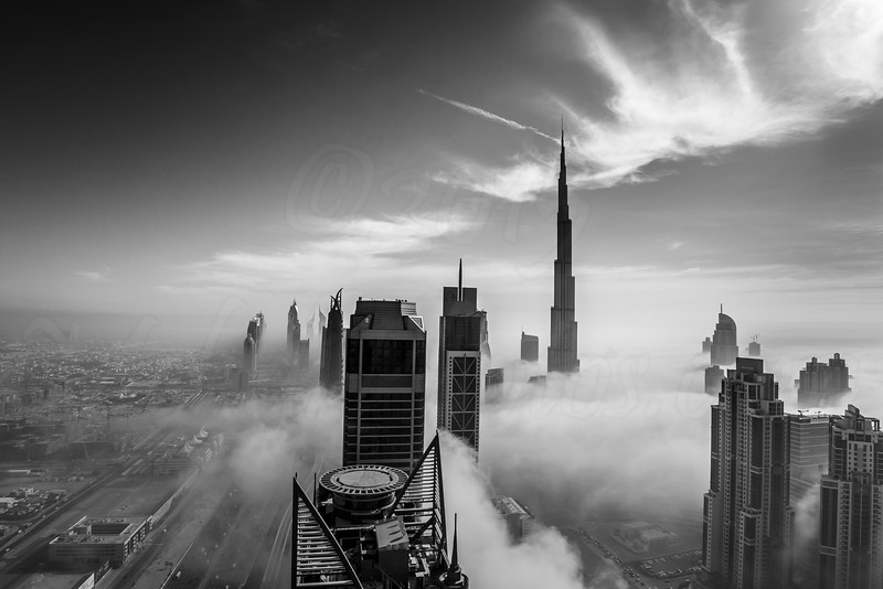 Early morning fog is covering Dubai business bay area. B&W