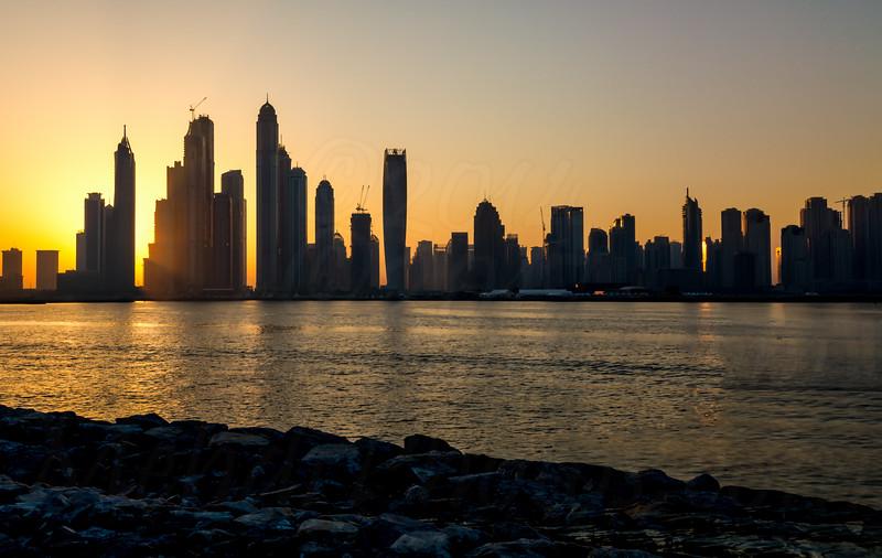 HDR Dubai Marina sunrise as seen from Palm Jumeira.