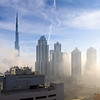 A foggy day in Business Bay with Burj Khalifa in the background on a cloudy and foggy day.