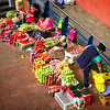 Woman selling produce in a Cuenca market