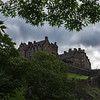 Edinburgh Castle is a fortress which dominates the skyline of the city of Edinburgh, Scotland, from its position atop the volcanic Castle Rock. Human habitation of the site is dated back as far as the 9th century BC, although the nature of early settlement is unclear. There has been a royal castle here since at least the reign of David I in the 12th century, and the site continued to be a royal residence until the Union of the Crowns in 1603. From the 15th century the castle's residential role declined, and by the 17th century its principal role was as a military base with a large garrison. Its importance as a historic monument was recognised from the 19th century, and various restoration programmes have been carried out since. As one of the most important fortresses in the Kingdom of Scotland, Edinburgh Castle was involved in many historical conflicts, from the Wars of Scottish Independence in the 14th century, up to the Jacobite Rising of 1745, and has been besieged, both successfully and unsuccessfully, on several occasions.<br /> Few of the present buildings pre-date the Lang Siege of the 16th century, when the medieval defences were largely destroyed by artillery bombardment. The most notable exceptions are St Margaret's Chapel, which dates from the early 12th century and is the oldest surviving building in Edinburgh,[2] the Royal Palace, and the early-16th-century Great Hall. The castle also houses the Honours of Scotland, the Scottish National War Memorial, and the National War Museum of Scotland.<br /> Edinburgh Castle is in the care of Historic Scotland, and is Scotland's most-visited paid tourist attraction, with over 1.3 million visitors in 2011.  The British Army is responsible for some parts of the castle, although its presence is largely ceremonial and administrative, including a number of regimental museums. As the backdrop to the annual Edinburgh Military Tattoo it has become a recognisable symbol of Edinburgh and of Scotland.