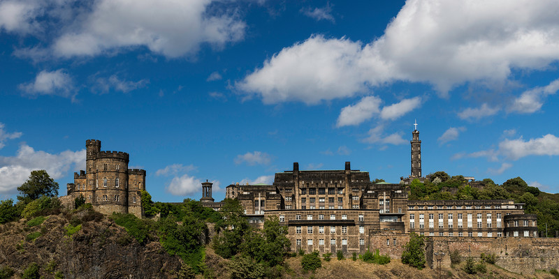 """St. Andrew's House (SAH), on the southern flank of Calton Hill in Edinburgh, is the headquarters building of the Scottish Government.  The building stands on the site of the former Calton Gaol. Today, the turreted Governor's House is all that remains of the former prison, next to the Old Calton Burial Ground and Political Martyrs' Monument.<br /> The large, Category A listed, Art Deco-influenced building looks out over Waverley station, the Canongate and Holyrood Park.<br /> <br /> The building was designed by Thomas S. Tait of Burnet, Tait and Lorne, architects, who won the architectural competition to gain the commission. Construction began in November 1935, and was completed in 1939, the building initially housed the Scottish Office, including the offices of the Secretary of State for Scotland. The requirement for the building arose as a result of a post World War I policy of limited transfer of devolved administrative (but not legislative) power to Scotland from London. An official opening ceremony timed to take place on 12 October 1939 was """"cancelled due to War"""" (Britain's first air raid of the war took place only four days later over the Forth Bridge). Instead, it was officially opened by King George VI and Queen Elizabeth on 26 February 1940.<br /> <br /> Architecturally, the building is monolithic, symmetrical and restrained on the main north facade. To the south, facing the Waverley valley, it is much more irregular and romantic in expression. There are many Art Deco influences.<br /> Tait's design incorporates elements of Art Deco and Streamline Moderne and is noted for being a rare example of sensitively designed modern architecture in Edinburgh.<br /> The building features a number of sculpted decorations, also in the Art Deco style, which are credited to several sculptors: Sir William Reid Dick designed symbolic figures; heraldic devices are the work of Alexander Carrick and Phyllis Bone; the large bronze doors were designed by Walter Gilbert and execut"""
