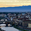 Arno River and Ponte Vecchio bridge. A Medieval stone arch bridge in Florence, Italy taken from Piazzale Michelangelo.