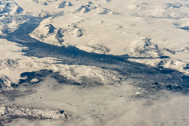 Greenland, East coast from 38,000 ft.  White specks are icebergs as big as houses.