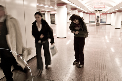 Moran zippes her coat at the M2 metro line exit. Budapest, Hungary, 2008.