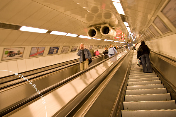Going up in the long-long escalator in the Metro. Budapest, Hungary, 2008.