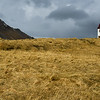 Mt Stapafell and church, Hellnar Village, Snaefellsnes Peninsula, Iceland (rock on top of mountain is/was Viking holy place called Fellskress)