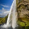 Seljalandsfoss waterfall, iceland you can see people walking behing it as we did.