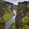 Fjaoragljufur canyon near Kirkjubbaejarklaustur, Iceland 330 feet deep, over mile long.