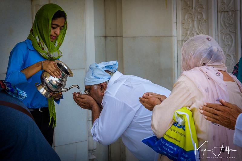 Receiving pilgrims at  Gurdwara Bangla Sahib.