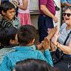 Arlene giving the kids high-fives.