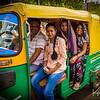 A family rides an auto-rickshaw in Agra.